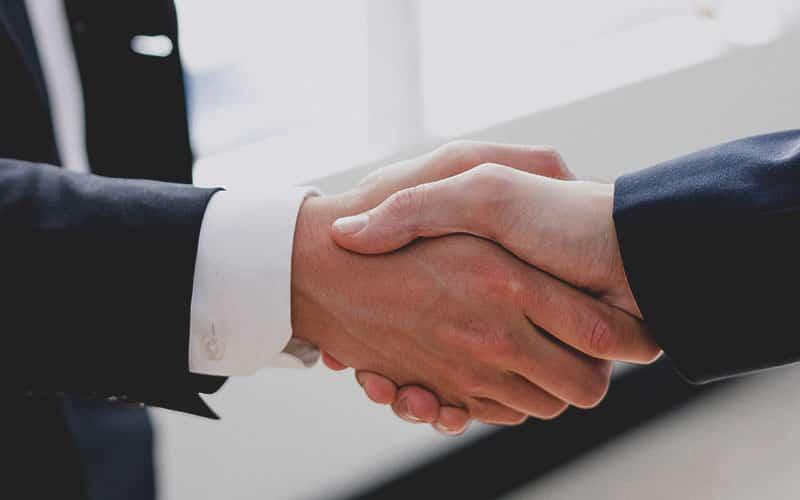 Two lawyer handshaking after case